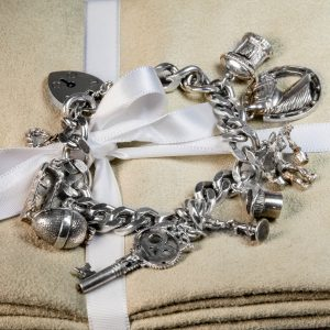 Shop Silver Curb Link Chain Bracelet with Charms - Order Online Today for Next Day Delivery - Sell Your Silver Jewellery to the Luxury Hut